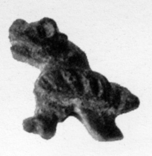 Fig.24–Snake-headed bird pendant.